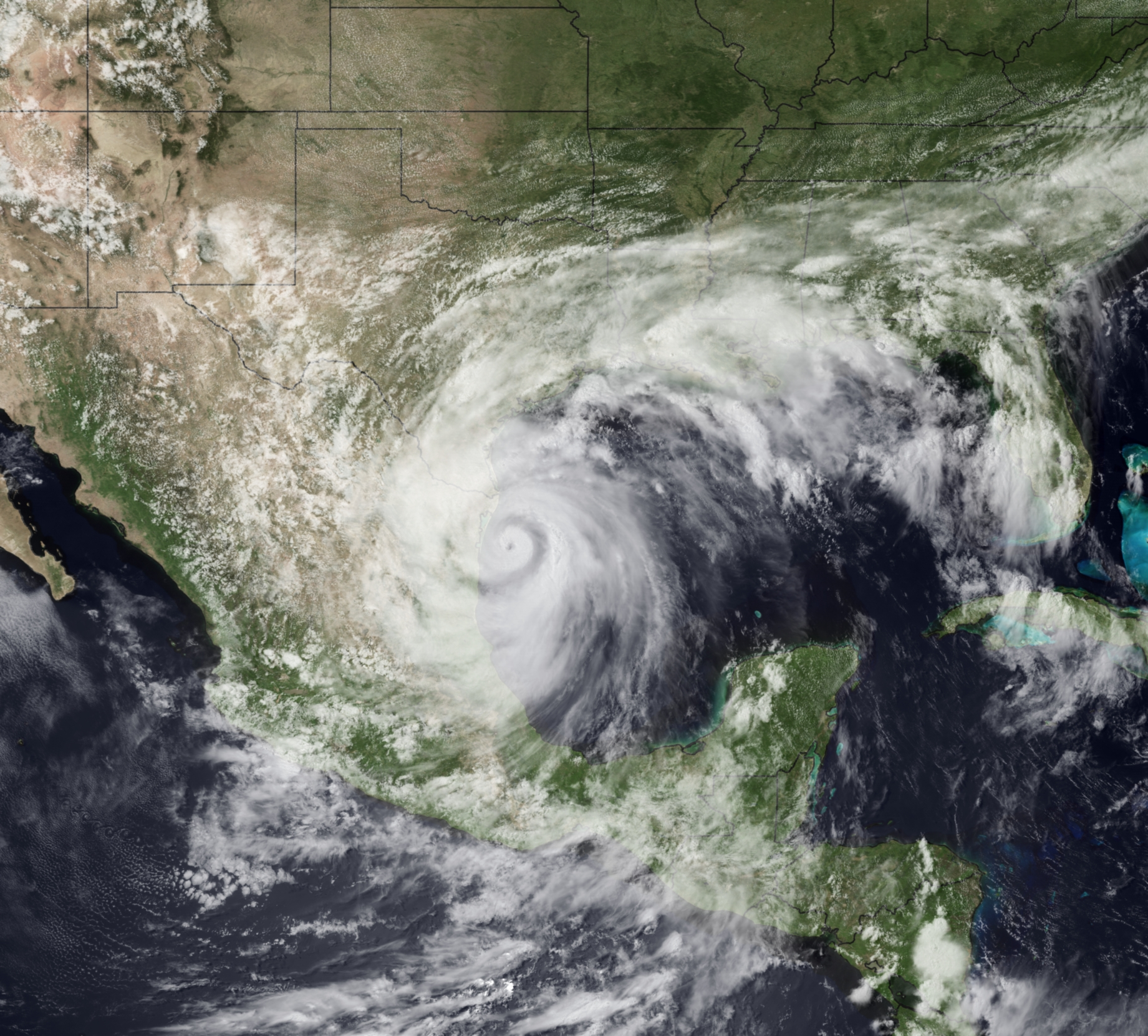 Satellite imagery of Tropical Storm Alex in the Gulf of Mexico prior to making landfall on 30 June 2010.