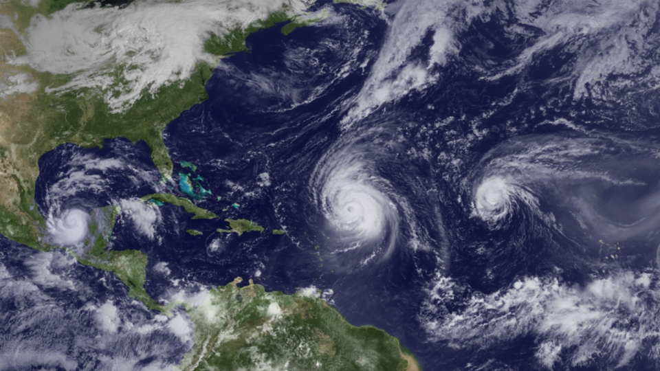 Satellite imagery of Hurricanes Igor, Julia, and Karl in the North Atlantic hurricane basin on 19 September