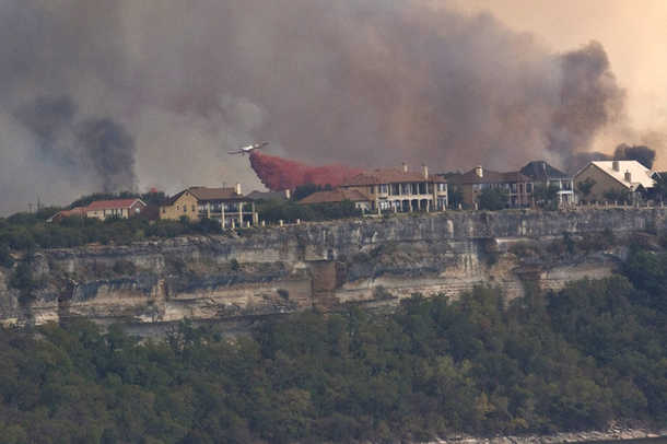 Aerial efforts to protect homes from a major fire on Possum Kingdom Lake in Texas