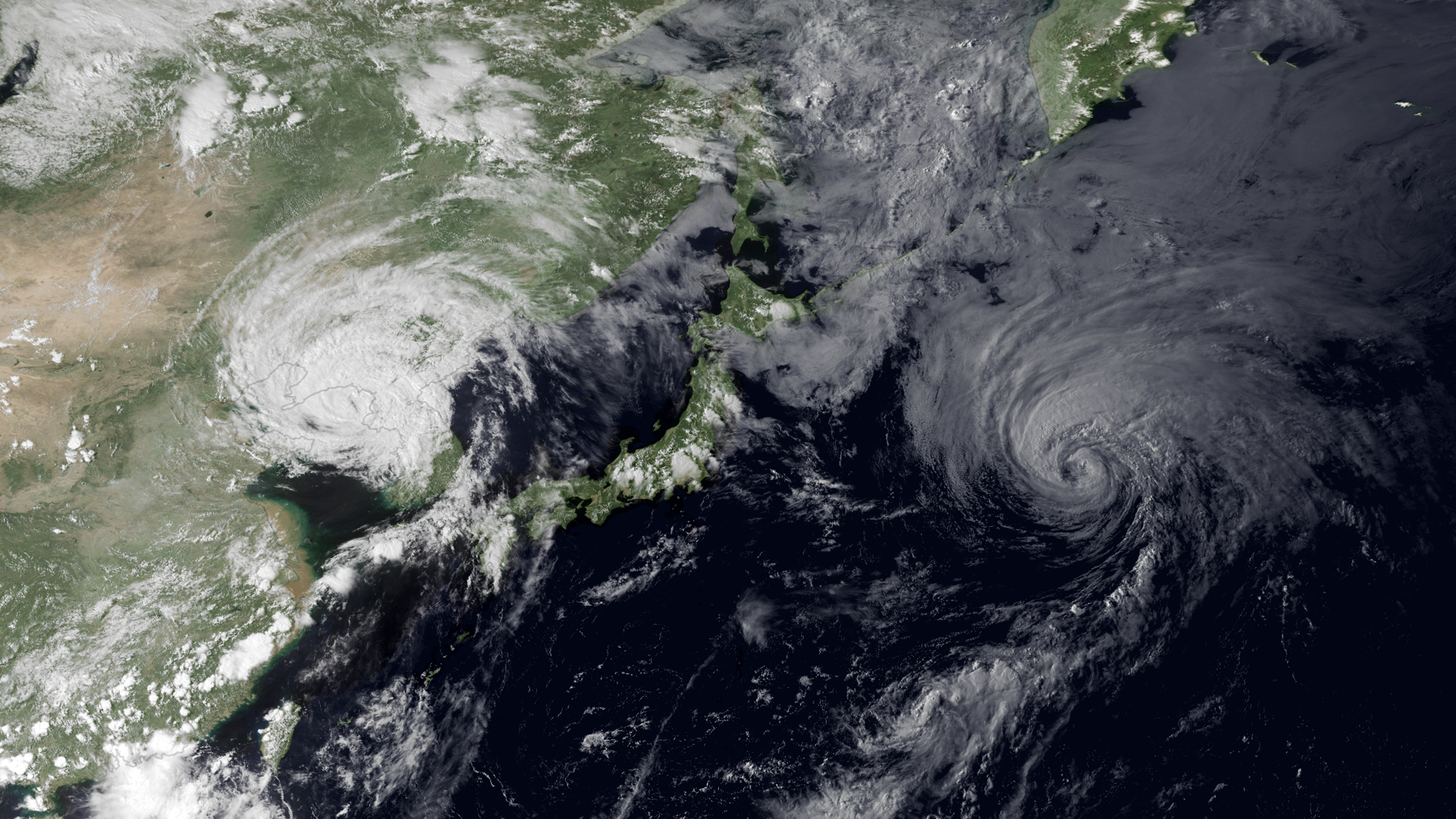 Tropical Storm Muifa making landfall over North Korea. Tropical Storm Merbok lies to the east.