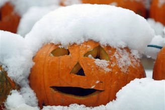 Snowfall in the northeastern U.S. covers a jack-o-lantern on 30 October